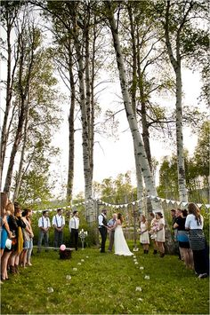 Guests stand during outdoor wedding ceremony