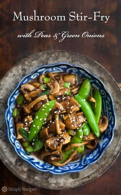 Mushroom Stir Fry with Peas and Green Onions ~ A simple sweet and spicy mushroom stir fry using honey, ginger, garlic, and dried chilies.  ~ SimplyRecipes.com