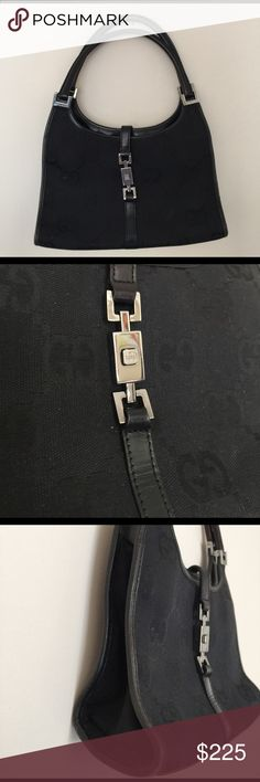 👛👛GUCCI JACKIE classic black shoulder bag Gucci JACKIE black classic logo bag with black leather trim and a magnetic silver clasp (hardware). Can be worn over the shoulder or used as a evening hand bag. Inside pocket. Originally $1200. Has some mild wear, please refer to the pictures or ask for further information. 100% Authentic. Gucci Bags Shoulder Bags