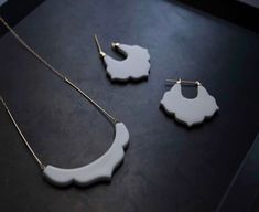 HiN is a new Japanese jewelry brand created by designer Haruka Okabe. HiN (品 in Japanese ), which means dignity, works with purveyors of traditional craft work to create contemporary designs. Porcelain Countertops, Porcelain Wood Tile, Porcelain Veneers, Porcelain Skin, Porcelain Jewelry, Ceramic Jewelry, Porcelain Ceramics, Clay Jewelry, White Porcelain