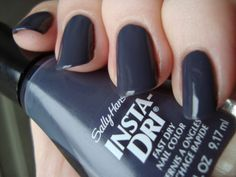 Sally Hansen Insta-Dri Grease Lightning is a dark blue-toned gray cream.