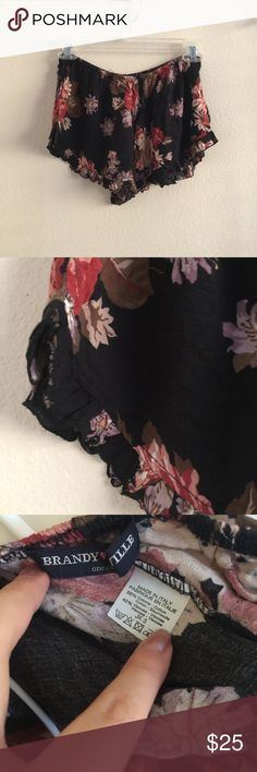 Dark Floral Print Vodi Shorts Red floral print on black vodi shorts with elastic waistband and ruffle trim. One size fits most from Brandy Melville! Never worn. Soft cotton blend material. Not sheer.     🚫Trades 🚫Off posh transactions or 🅿️🅿️ 🚫negotiating in comments  🚷lowballs blocked ✅REASONABLE offers ✅Bundle for 30% off for 3 items or more. Brandy Melville Shorts
