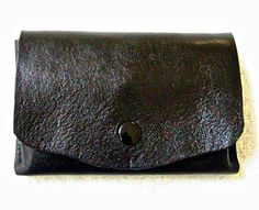 Small black leather wallet by WoodBoneAndStone on Etsy, $25.00