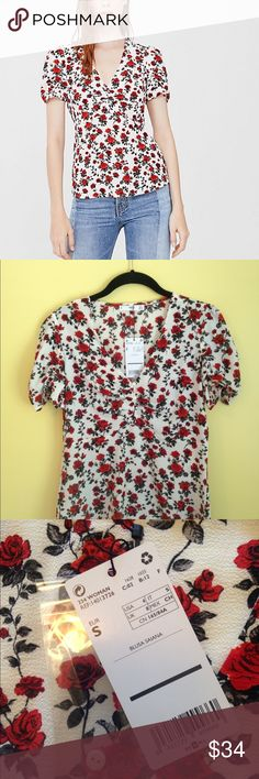NWT Mango Floral Top Brand new floral top with short sleeves. V-neck with small buttons and flattering, fitted bodice. Mango Tops