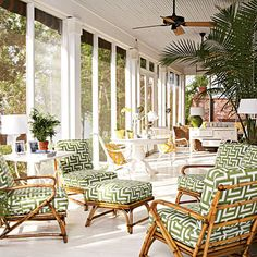 screened porch.  bamboo lounge chairs + white + graphic green upholstery