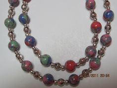 Handmade Pretty splotches of color necklace by Donna's Lake View Designes