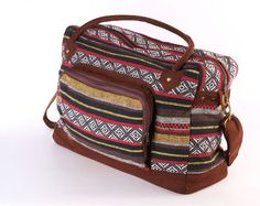 This perfect stylish weekender bag can be your companion on your journeys. With the easy to carry top handles, just pick up and go! This very light weight bag is a great choice for all age. Perfect size for road trips, weekend getaways, overnight trips and in your everyday coming and going. Beautiful handmade weekender bag/tote made of Tribal striped woven cotton fabric. Top has an zipper opening and inside has one small zipped pocket for your passport and other small items. Very strong...