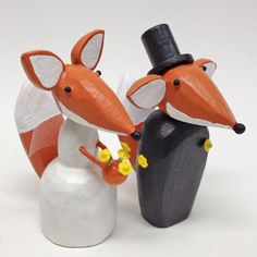 Bride and Groom Foxes for your Wedding Cake by bunnywithatoolbelt on Etsy https://www.etsy.com/listing/72818597/bride-and-groom-foxes-for-your-wedding