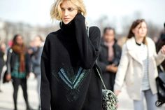 Polish fashion model Anja Rubik on a street style photo taken after Elie Saab during Paris Fashion Week.