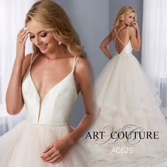 A modern, Mikado bodice sets the stage for this fun and flirty gown. Thin, beaded straps begin at the front neckline then cross at the open back. A matching, thin, beaded belt wraps around the waist. The skirt is made of layers of cascading tulle that is finished with horsehair.
