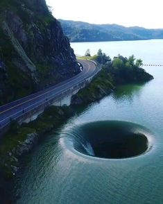The Glory Hole from Located in Lake Berryessa, this hole was manufactured to work as a drain for the Monticello Dam. Carrying 526 BILLION GALLONS of water, it is a safe way of transporting water to the surrounding area. Beautiful Places To Travel, Wonderful Places, Cool Places To Visit, Places To Go, Amazing Places On Earth, Nature Pictures, Amazing Nature Photos, Amazing Pictures, Beautiful Landscapes