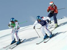 Gold medallist Jean Frederic Chapuis (L) of France leads from silver medallist Arnaud Bovolenta of France and Brady Leman (red top) of Canada, during the Freestyle Skiing Men's Ski Cross Big Final. Sochi 2014 - Best of Day 14.