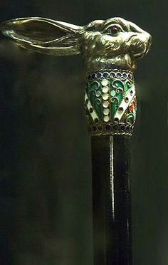 Silver Dress Cane-Circa 1880- A cast solid silver handle of a hares head, accented by a beaded, enameled collar, ebony shaft and a  enameled ferrule.