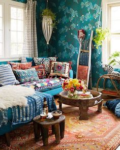 Layered African indigo textiles with vintage Peruvian and kilim pillows make for a cozy and colorful bohemian living room style.