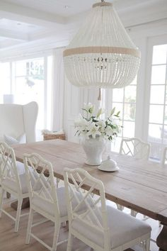 Dining  Furniture Ideas :     Neutral Dining Room. Neutral Dining room. Neutral Dining room with reclaimed wood table, white chairs and white beaded chandeliers.    -Read More –