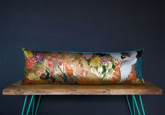 This stunning upcycled Kimono cushion is handmade with original luxury gold vintage brocade silk and gilt thread from an authentic high status Uchikake wedding kimono.Glittering and shimmering in the light, this large bolster cushion (92cm long x ...