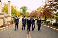 The guys walking down the road. ::Hillary + Paul's outdoor garden wedding at the Heritage Hotel in Southbury, Connecticut:: #street #road #men #walking #weddingphotography #groomsmen #groupshot #fall #autumn