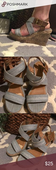 Merona blue and white nautical stripe wedges Size 6.5. The brown coating on inside of shoe is peeling off but the rest of the shoe is in great shape. Super cute shoes!! Merona Shoes Wedges