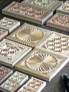Detail of carved wooden plaques, serving platters, trivets, and coasters (Made and carved by Dave Melnychuk)