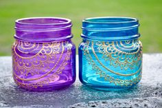 On sale! This mason jar lantern is hand-painted and is inspired by the beauty of henna art. Makes a lovely gift! Size: half-pint Colors(as pictured in 1st photo): Red, Turquoise, Purple, Sapphire (other colors are available) Use as: *Candle holder *Desktop organizer (perfect for
