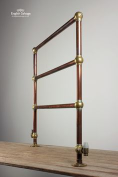 antique copper and brass towel rail: perrin rowe lifestyle