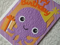 This is such a cute card. It looks like they used a Sizzix or Cuttlebug too for the octopus. AACK! I love it.