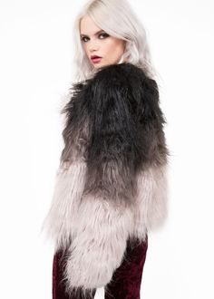 Glam up any look with this rad faux fur jacket! It flaunts a chunky faux-fur fabrication in a black and grey ombre look that is lined for warmth. It has a collarless design and long sleeves. Available