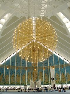 Chandelier inside Faisal Mosque in Islamabad, Pakistan. Made of gold plated aluminium tubes, it weighs 7.5 tons and uses 1,000 electric bulbs. Photo by Farrukh, via Flickr.