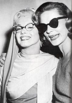Marilyn Monroe and Lauren Bacall photographed during the filming of How to Marry a Millionaire, 1953