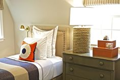 Suzie: Sam Allen Interiors - Fun boy's bedroom with tan headboard with French brass tacks, ...