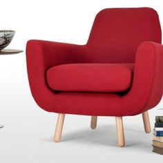 Jonah armchair in berry red. Created by young British designer James Harrison.