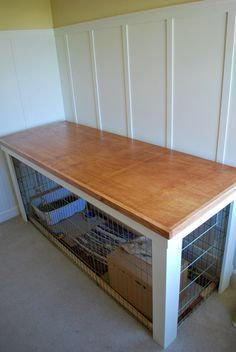 Sewing table over bunny cage condo. https://flic.kr/p/JDfuPy | Bunny Condo/Xpen AFTER | The 2x6' Xpen configuration for our Holland Lop rabbit sits in my sewing room and was taking up precious real estate. I saw wasted space above the Xpen and finally put my plan into action. Table top is removable so we can easily move the table out of the room if necessary.