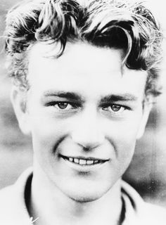 High School Portrait of John Wayne He was a very handsome man..cant imagine his sexy, suave` voice at that age. mhmm
