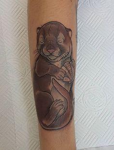 Aimee Bray otter tattoo