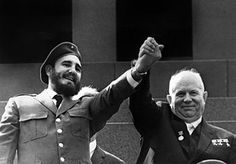 Holding the hand of Soviet leader Nikita Khrushchev during a four-week official visit to Moscow, 1963