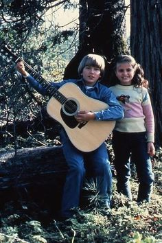 A young River and Rain Phoenix