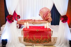 Stage for Sudanese wedding by Davinci Florist. Photography by Sachi Anand.