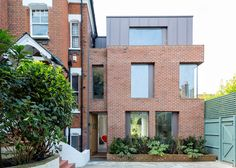 Alexander Martin Architects has added a three-storey extension to a Victorian house in London, featuring brick walls and a big window facing the garden Zinc Cladding, Roof Cladding, Brick Architecture, Residential Architecture, Brick Extension, Extension Ideas, Modern Brick House, Brick Face, London House