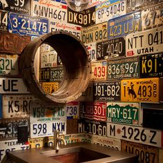 rustic  bathroom. Line the walls with license plates, make a mirror from a tire rim
