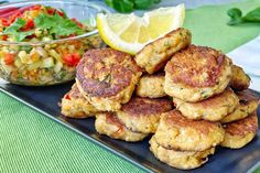 Spicy, tangy and fragrant with Asian herbs, these fish cakes are easy to make and are the perfect holiday party nibbles. Unlike traditional fish cakes that are made with flour, these Spiced Tuna Fishcakes with Thai Basil Stir Fry have a refreshing mix of water chestnuts and flaky canned tuna that makes them healthy low carb alternatives for the snack table. Pair them with tropical cocktails or mocktails for the festive season! Tuna Fish Cakes, Asian Food Channel, Stir Fry Ingredients, Party Nibbles, Green Zucchini, Fishcakes, Carb Alternatives, Thai Cooking, Asian Recipes