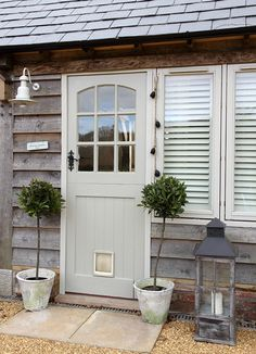 French Gray Dutch door, potted topiaries