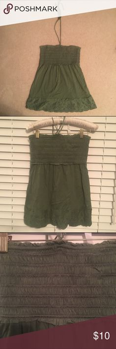 Super Comfy Green Top! Very comfortable and flattering green top with cute lace detail on the bottom! It has halter-type spaghetti straps that come up from the middle. The chest area is very stretchy and the bottom part hangs loose. Fits true to size! Bundles and reasonable offers are welcome! American Eagle Outfitters Tops