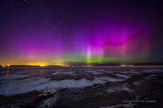 Northern lights over frozen Puck Bay, Poland.