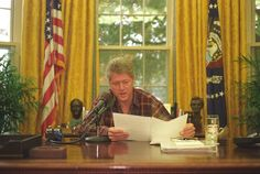 Photograph of President William J. Clinton Delivering the Weekly Radio Address in the Oval Office, 11/06/1993.  http://research.archives.gov/description/5701025