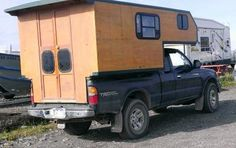 Custom Built Truck Camper: Isn't this homemade camper neat and tidy looking? That's one of the first things I noticed about it. It's not hacked together like some do-it-yourself