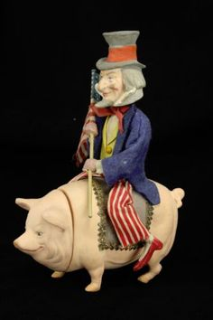 Antique-German-Uncle-Sam-Nodder-on-Pig-Candy-Container-ca1910
