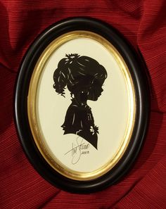 Silhouette by Tim Arnold in a  Classic Wooden Oval. Excellent Christmas Gift