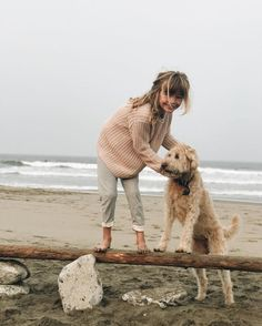 cozy sweaters and puppy on the beach