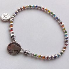 Om Shanthi Sterling Silver Chakra bracelet.  Original design.  The Connie Hanna Jewels.  Sterling lotus charm chakra jewelry