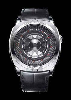 O Harry Winston Opus XIII apresenta 11 pequenos ponteiros triangulares para horas e outros 59 para minutos, que se esticam e retraem ao longo do tempo.
